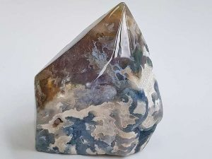 Polished Moss Agate point approx size 60 x 50 mm Being a natural product this crystal may have natural blemishes. www.naturalhealingshop.co.uk based in Nuneaton for crystals, spiritual healing, meditation, relaxation, spiritual development,workshops.