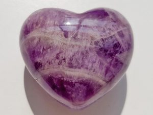 Highly polished Chevron Amethyst Heart approx 45 mm. These hearts are perfect for a gift! There are purple velvet pouches or organza bags you can purchase to pop them into for the finishing touch. Being a natural product these stones may have natural blemishes and vary in colour and banding. www.naturalhealingshop.co.uk based in Nuneaton for crystals, spiritual healing, meditation, relaxation, spiritual development,workshops.