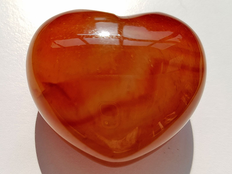 Highly polished Carnelian Heart approx 45 mm. These hearts are perfect for a gift! There are purple velvet pouches or organza bags you can purchase to pop them into for the finishing touch. Being a natural product these stones may have natural blemishes and vary in colour and banding. www.naturalhealingshop.co.uk based in Nuneaton for crystals, spiritual healing, meditation, relaxation, spiritual development,workshops.