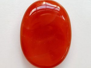 Highly polished Carnelian thumb stone 40 x 30 mm. The thumb stones have been designed to have a pleasing feel with the highest quality finish. They are shaped to fit beautifully between the thumb and fingers. Being a natural product these stones may have natural blemishes and vary in colour and banding. www.naturalhealingshop.co.uk based in Nuneaton for crystals, spiritual healing, meditation, relaxation, spiritual development,workshops.