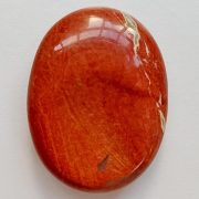 Highly polished red jasper thumb stone 40 x 30 mm. The thumb stones have been designed to have a pleasing feel with the highest quality finish. They are shaped to fit beautifully between the thumb and fingers. Being a natural product these stones may have natural blemishes and vary in colour and banding. www.naturalhealingshop.co.uk based in Nuneaton for crystals, spiritual healing, meditation, relaxation, spiritual development,workshops.