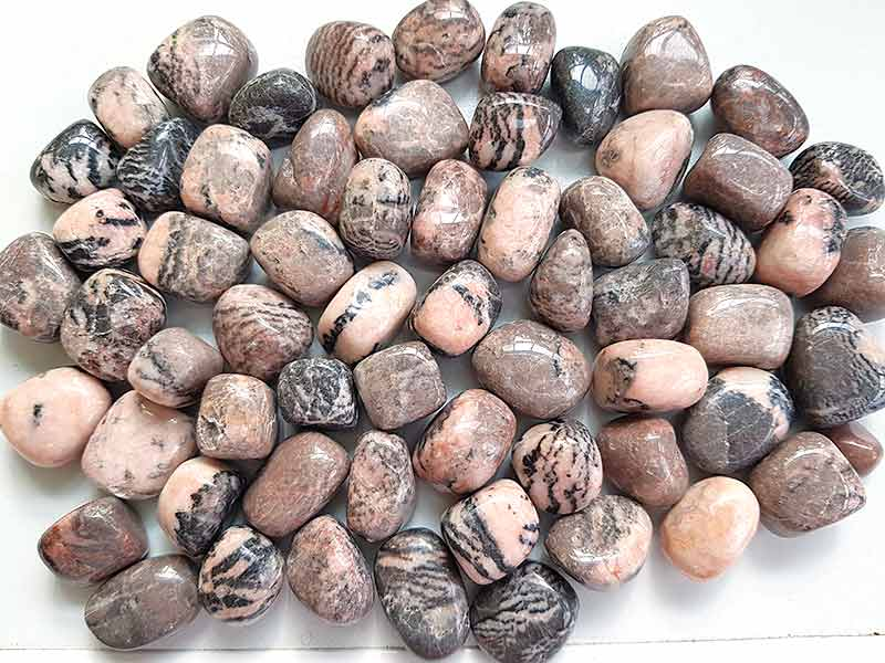 Highly polished Zebra Jasper tumble stone size 2-3 cm. Being a natural product these stones may have natural blemishes and vary in colour, banding and shape. See photograph. www.naturalhealingshop.co.uk based in Nuneaton for crystals, spiritual healing, meditation, relaxation, spiritual development,workshops.