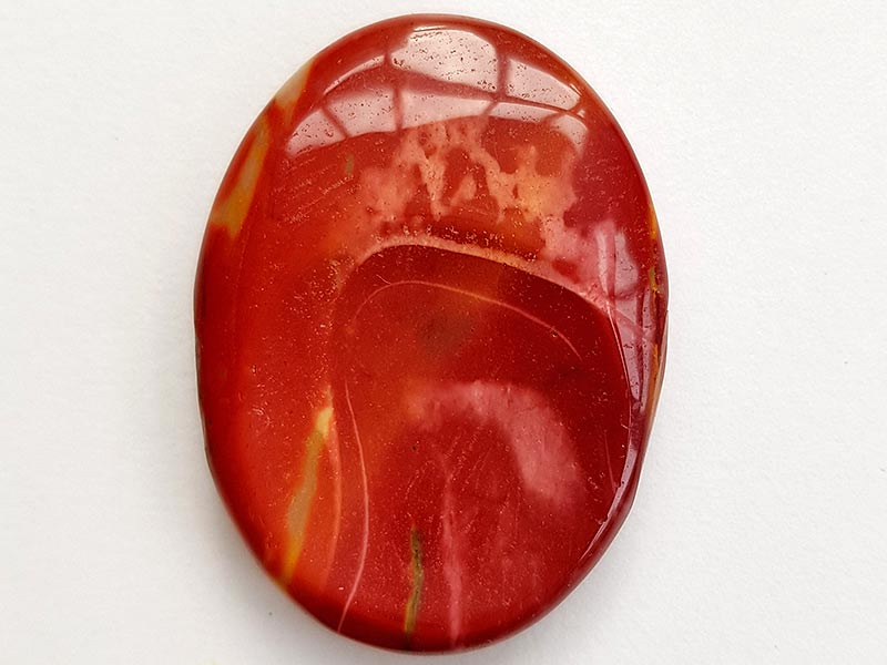 Highly polished Mookaite thumb stone 40 x 30 mm. The thumb stones have been designed to have a pleasing feel with the highest quality finish. They are shaped to fit beautifully between the thumb and fingers. Being a natural product these stones may have natural blemishes and vary in colour and banding. www.naturalhealingshop.co.uk based in Nuneaton for crystals, spiritual healing, meditation, relaxation, spiritual development,workshops.