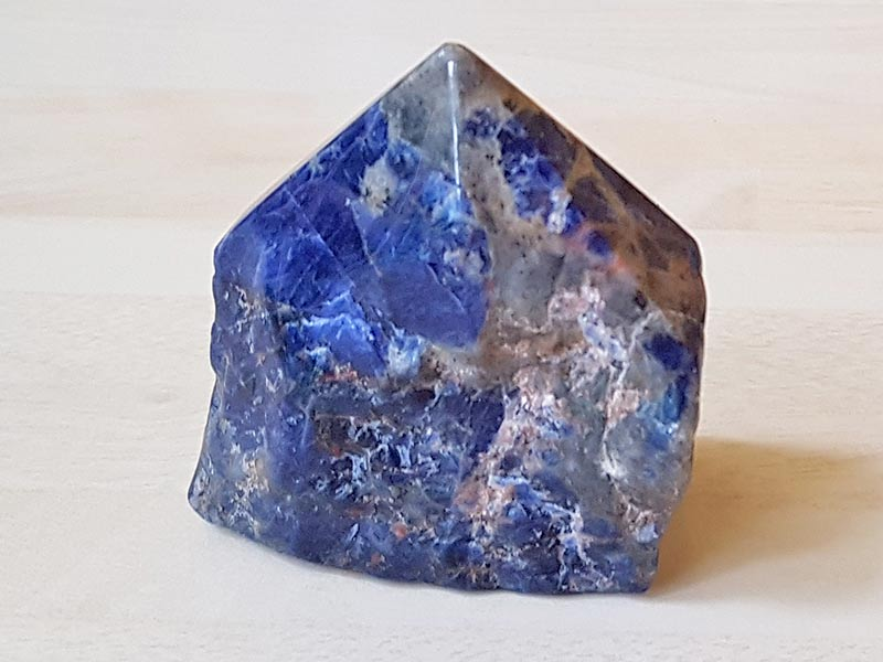 Polished Sodalite point approx size 60 mm Being a natural product this crystal may have natural blemishes. www.naturalhealingshop.co.uk based in Nuneaton for crystals, spiritual healing, meditation, relaxation, spiritual development,workshops.