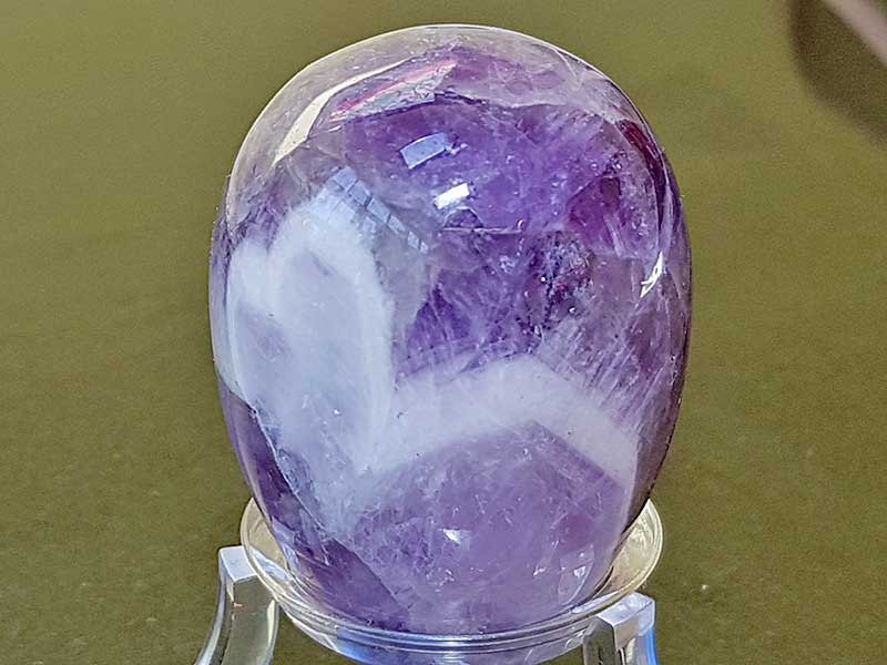Highly polished Chevron Amethyst crystal egg approximate height 45 mm. Beautiful to collect or hold and meditate with. Being a natural product these stones may have natural blemishes and vary in colour and banding. www.naturalhealingshop.co.uk based in Nuneaton for crystals, spiritual healing, meditation, relaxation, spiritual development,workshops.