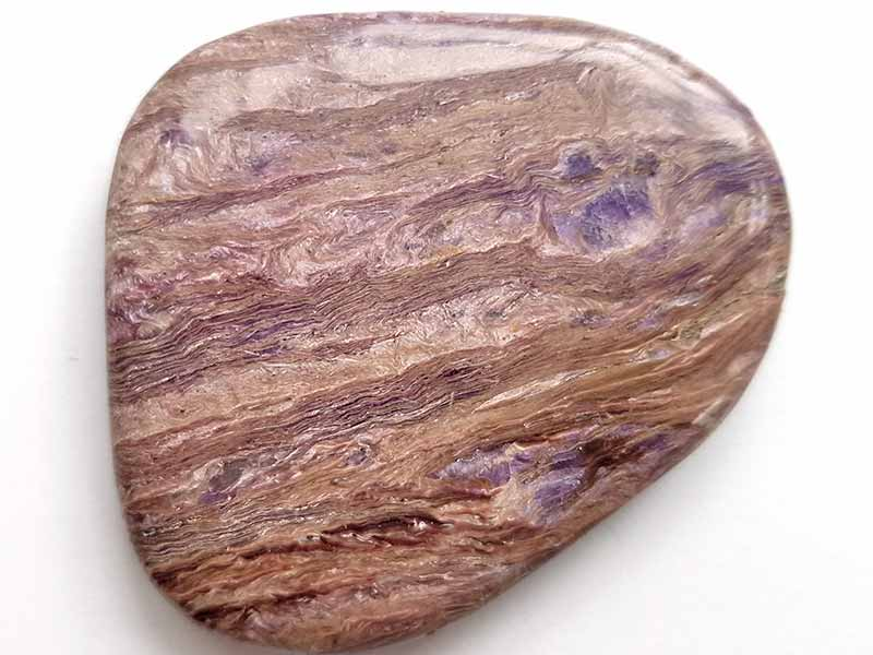 Highly polished Charoite comfort stone approx size 55 x 50 mm Being a natural product this crystal may have natural blemishes and vary in colour and banding. www.naturalhealingshop.co.uk based in Nuneaton for crystals, spiritual healing, meditation, relaxation, spiritual development,workshops.