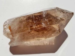 Rough Smoky Quartz point approximate length 65 mm. Being a natural product this crystal may have natural blemishes and vary in colour and banding. www.naturalhealingshop.co.uk based in Nuneaton for crystals, spiritual healing, meditation, relaxation, spiritual development,workshops.