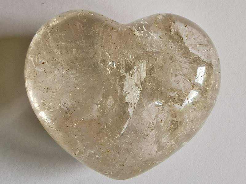 Highly polished Quartz Heart approx 45 mm. These hearts are perfect for a gift! There are purple velvet pouches or organza bags you can purchase to pop them into for the finishing touch. Being a natural product these stones may have natural blemishes and vary in colour and banding. www.naturalhealingshop.co.uk based in Nuneaton for crystals, spiritual healing, meditation, relaxation, spiritual development,workshops.
