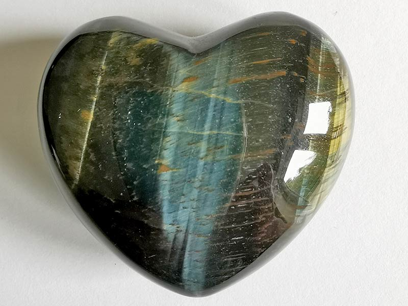 Highly polished Blue Tigers Eye Heart approx 45 mm. These hearts are perfect for a gift! There are purple velvet pouches or organza bags you can purchase to pop them into for the finishing touch. Being a natural product these stones may have natural blemishes and vary in colour and banding. www.naturalhealingshop.co.uk based in Nuneaton for crystals, spiritual healing, meditation, relaxation, spiritual development,workshops.