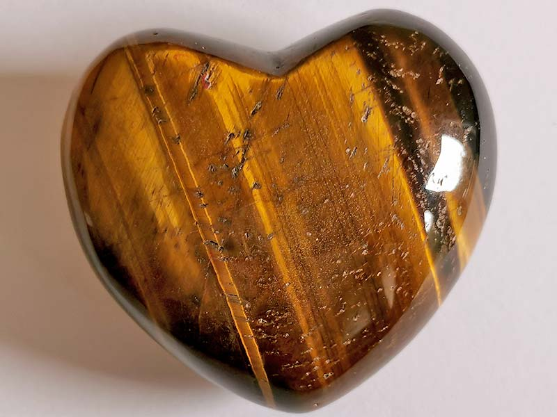 Highly polished Golden Tigers Eye Heart approx 45 mm. These hearts are perfect for a gift! There are purple velvet pouches or organza bags you can purchase to pop them into for the finishing touch. Being a natural product these stones may have natural blemishes and vary in colour and banding. www.naturalhealingshop.co.uk based in Nuneaton for crystals, spiritual healing, meditation, relaxation, spiritual development,workshops.