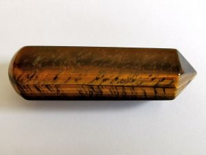Highly polished Tiger Eye wand approximate height 70 mm Used in crystal healing and meditation. Excellent for collectors. www.naturalhealingshop.co.uk based in Nuneaton for crystals, spiritual healing, meditation, relaxation, spiritual development,workshops.