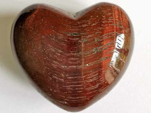 Highly polished Red Tigers Eye Heart approx 45 mm. These hearts are perfect for a gift! There are purple velvet pouches or organza bags you can purchase to pop them into for the finishing touch. Being a natural product these stones may have natural blemishes and vary in colour and banding. www.naturalhealingshop.co.uk based in Nuneaton for crystals, spiritual healing, meditation, relaxation, spiritual development,workshops.