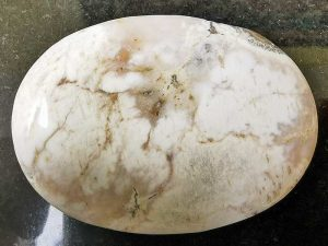 Highly polished Dendritic Agate palm stone 70 x 40 mm. The palm stones are made from the best grade rough materials to produce a well finished, highly polished product. Used by crystal healers and general therapists for massage and similar treatments. Also perfect for collectors. Being a natural product these stones may have natural blemishes and vary in colour and banding. www.naturalhealingshop.co.uk based in Nuneaton for crystals, spiritual healing, meditation, relaxation, spiritual development,workshops.