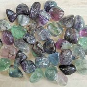 Highly polished Rainbow Fluorite tumble stone size 2-3 cm. Being a natural product these stones may have natural blemishes and vary in colour, banding and shape. See photograph. www.naturalhealingshop.co.uk based in Nuneaton for crystals, spiritual healing, meditation, relaxation, spiritual development,workshops.