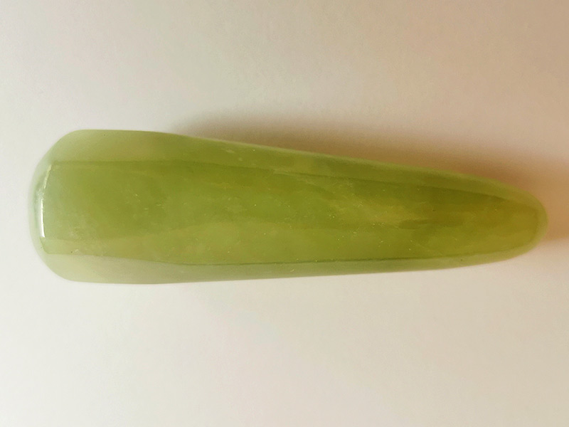 Highly polished New Jade Wand wand approximate height 80 mm Used in crystal healing and meditation. Excellent for collectors. Being a natural product this crystal may have natural blemishes and vary in colour. www.naturalhealingshop.co.uk based in Nuneaton for crystals, spiritual healing, meditation, relaxation, spiritual development,workshops.