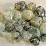 Highly polished Prehnite with Epidote tumble stone size 2-3 cm. Being a natural product these stones may have natural blemishes and vary in colour, banding and shape. See photograph. www.naturalhealingshop.co.uk based in Nuneaton for crystals, spiritual healing, meditation, relaxation, spiritual development,workshops.
